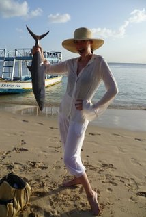 Paget Brewster with a fish