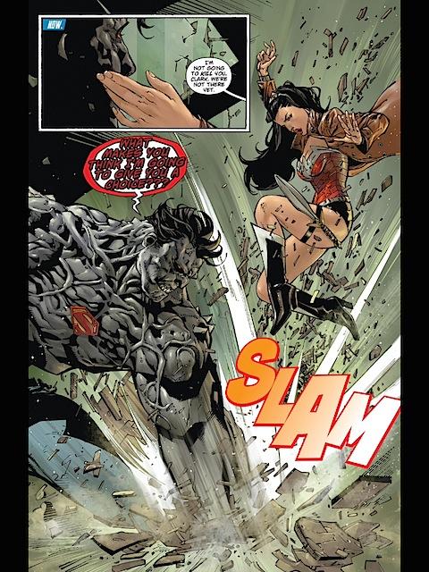 Superman tries to hit Wonder Woman