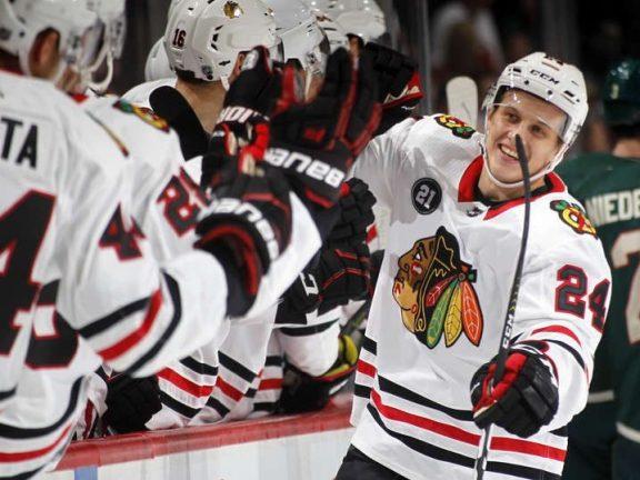 The Rink 1051921128_slide-1-e1539355407593 Game Recap: Blackhawks fall to Wild 4-3 in OT Jonathan Toews Dominik Kahun Chicago Blackhawks Alex Debrincat