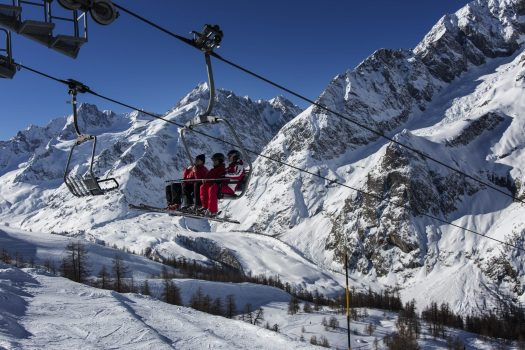 Chairlift ride up in Courmayeur Mont Blanc. Courmayeur Mont Blanc Funivie is opening two new slopes with amazing panoramic views.