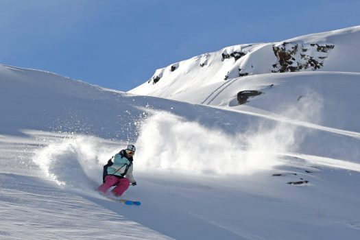 A skier is having a great time skiing in Sierra Nevada