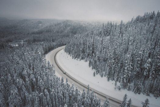 Driving with snow- check if you need snow tyres and/or snow chains. Photo Adrian- Unsplash- Driving to the mountains - winter tyres, snow chains.
