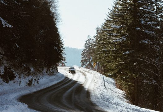 Driving to the mountains- check if you need to have snow tyres and snow chains. Photo Jeffrey Wegrzyn- Unsplash. Winter tyres, snow chains. Driving to the mountains