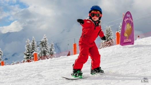 A kid on snowboard school at La Rosiere