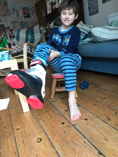 My kid is excited with his new ski boots!