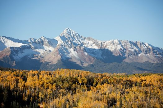The beautiful San Juan Mountains in the background of Telluride. Photo: Telluride Ski Resort.