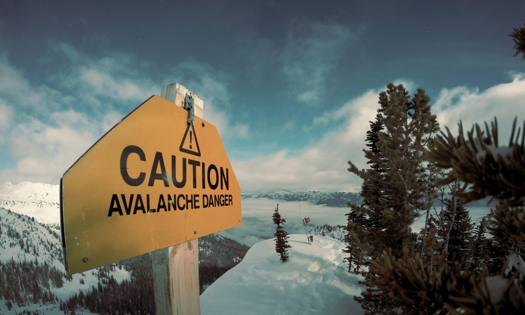 Caution avalanche sign - Photo by Nicolas Cool - Unsplash - Avalanche crashes into hotel in eastern Switzerland.