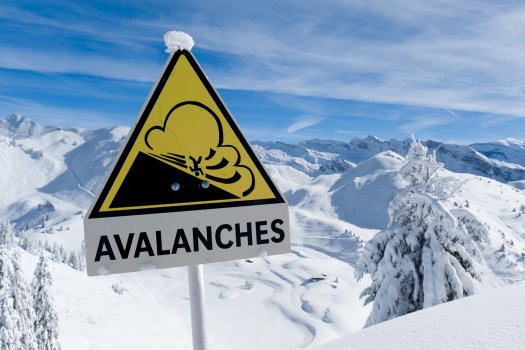 Avalanche sign in winter Alps with snow