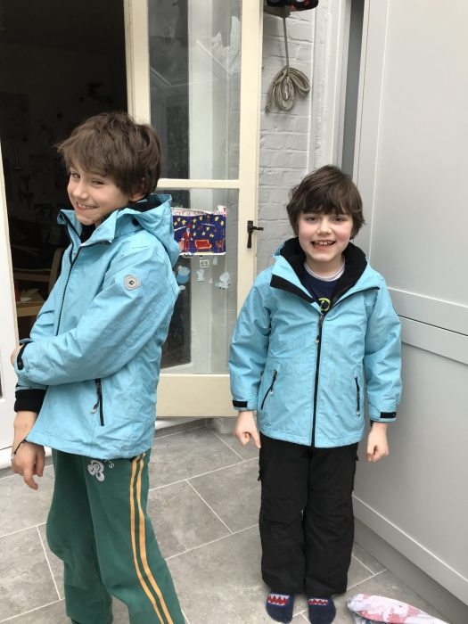 The boys model their jackets - bought four years ago in Munich - they have been a winner!
