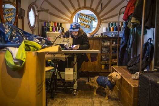 Patagonia van goes around all ski resorts repairing Patagonia kit and explaining how to do it yourself.