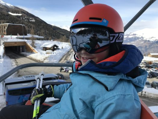 My eldest riding up the chairlift- Photo by The-Ski-Guru.