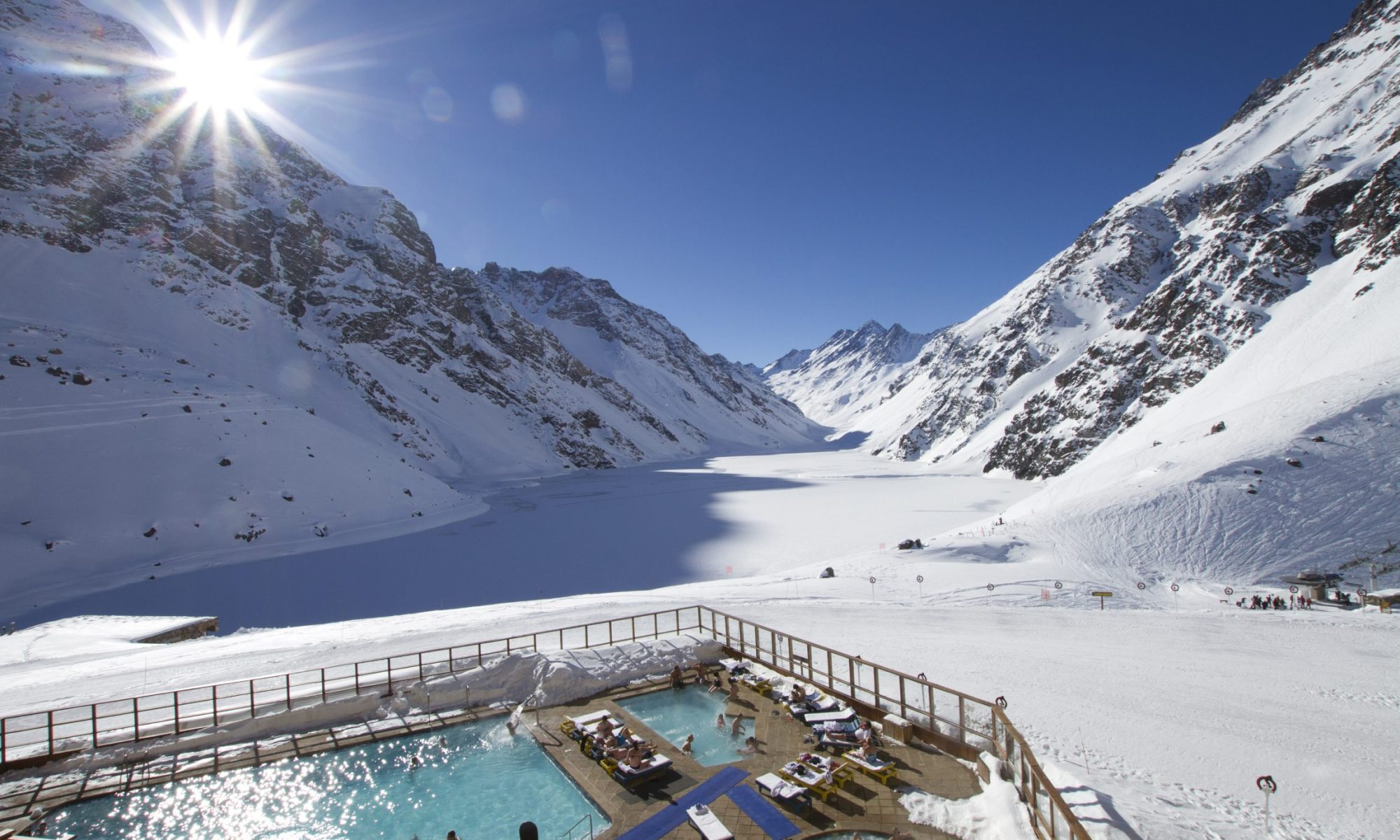 A room with a view- Photo by Adam Clark- Ski Portillo - view of the frozen Lake Inca and the Three Brothers peak in the background. Travel with us and we'll organise your perfect ski holiday.