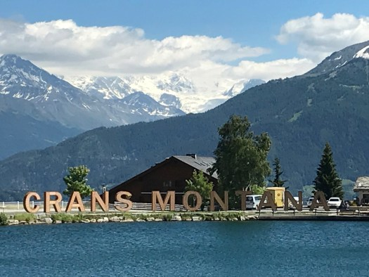 The Crans-Montana letters are by the side of one of the 7 lakes in Crans-Montana. Photo credit: The-Ski-Guru.