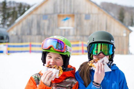 Kids enjoy their lunch at Mount Snow, VT. Peak Resorts.