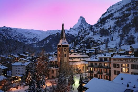 Zermatt at night, with the majestic Matterhorn viewing over it.