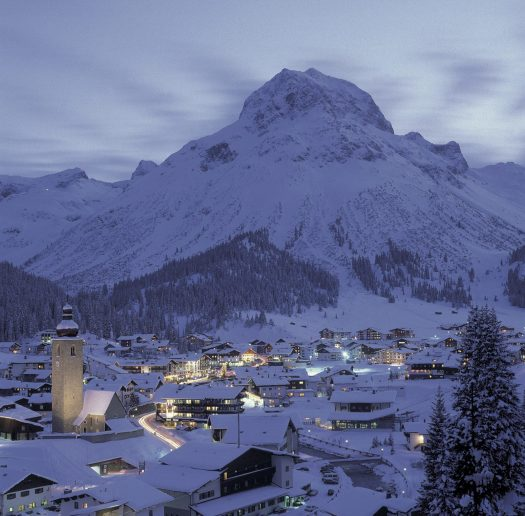 The Omeshorn towering the picture perfect town of Lech - Lech Zürs am Arlberg by night by Felder- Lech Zürs Tourismus. Must-Read Guide to Lech.