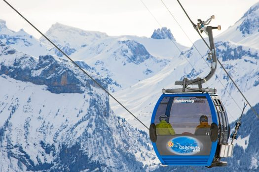 KANDERTAL TOURISMUS -  Oeschinensee - Gondola. Ride up with the 8-passenger gondolas from Kandersteg to Oeschinen. Floor level entry and exit, also suitable for strollers, seniors and wheelchairs. Copyright by Kandertal Tourismus By-line: swiss-image.ch/Martin Keller. Adelboden Lenk Kandersteg: What is going on for the 2018-19 ski season.