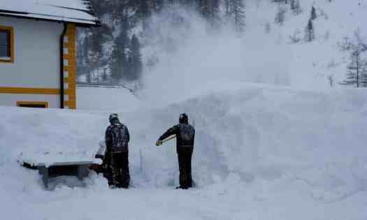 Workers clearing snow in the Austrian resort of Obertauern. Austria got hit by lots of snow this past week. Three German Skiers got killed in an Avalanche near the Austrian resort of Lech, fourth is missing.