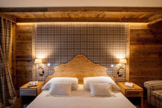 An executive room at the Gran Baita, with wood panelled walls. Spot on: Gran Baita Hotel – Courmayeur