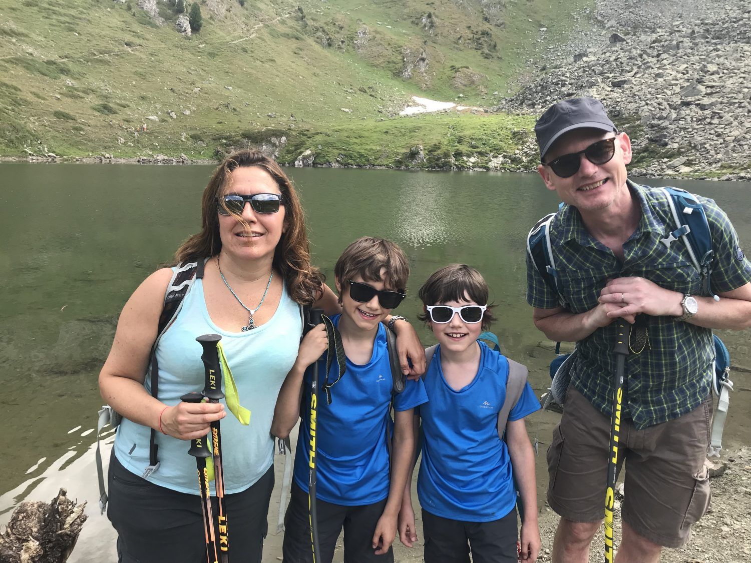The family by Lago Chamolé in Pila, Aosta Valley. Your shopping guide to mountain hiking apparel and equipment.