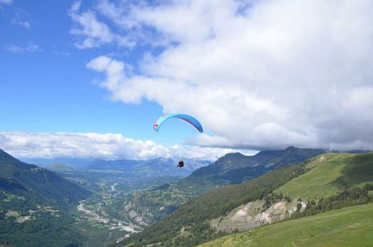 Paragliding in the Alps. Photo: Undiscovered Mountains. The Southern French Alps are the Best Part of the French Alps for Summer Activities.