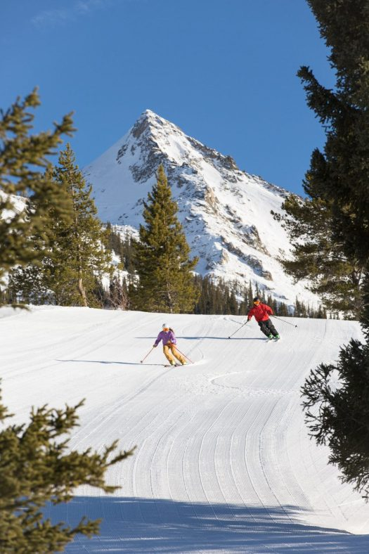 Skiers coming down the front of the mountain with the Butte on the background. Photo: Taylor Ahearn/CBMR. Final Record of Decision Published for Teocalli Drainage Expansion Project.