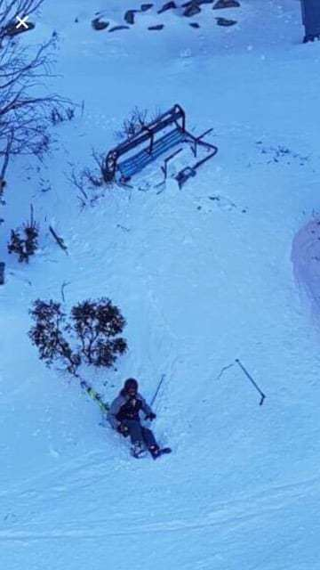 The skier with the broken chair. Skier falls from chairlift in Threbdo after becoming dislodged due to strong winds.