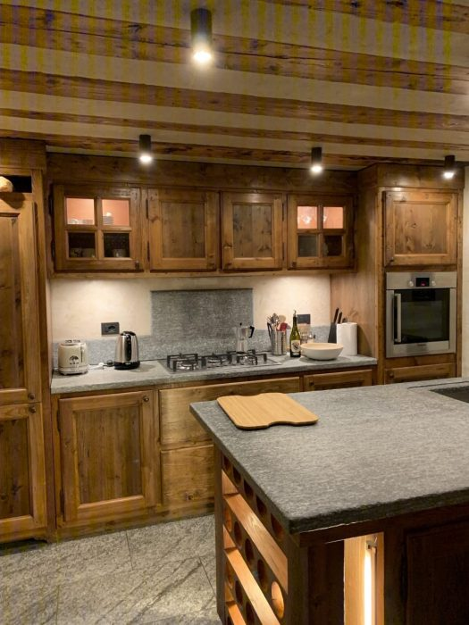 The kitchen of the apartment Il Cuore della Valdigne, all made in stone and wood, with the pan de bois on the ceiling. Aiguille du Midi vs Punta Helbronner – which one you should do?