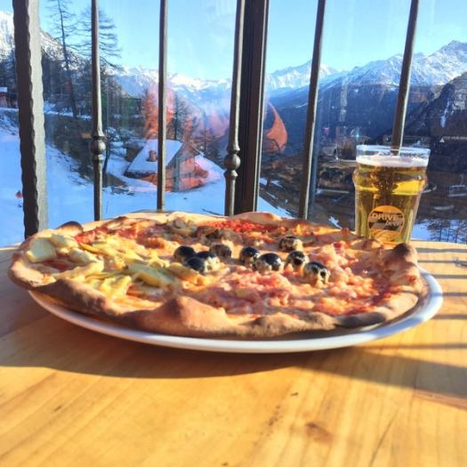 Pizza with the views - inside Chez Ollier. A Foodie Guide to on-Mountain Dining in Courmayeur.