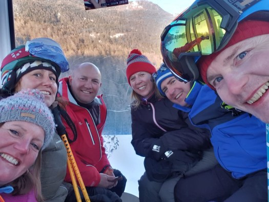 The grown-ups riding down the gondola from Pila. Our half term ski-safari holiday based in the Valdigne of Aosta Valley- Courmayeur, Pila and La Thuile.