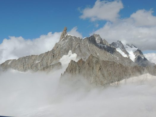 The Dent de Géant between the clouds, I took this photo from the top of Punta Helbronner. Aiguille du Midi vs Punta Helbronner – which one you should do?