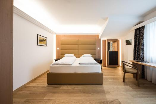 Double bedroom at the Haus am Hang. Book your stay at the Haus am Hang here. A Must-Read Guide to Summer in South Tyrol.