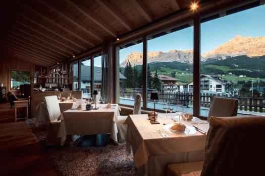 The dining room at the Hotel Antines in La Villa. Book your stay at the Hotel Antines here. Planning your summer in the mountains of Alta Badia.