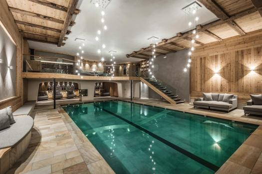 The interior pool at the Hotel Kolfuschgerhof. Book your stay at the Kolfuschgerhof here. Planning your summer in the mountains of Alta Badia.