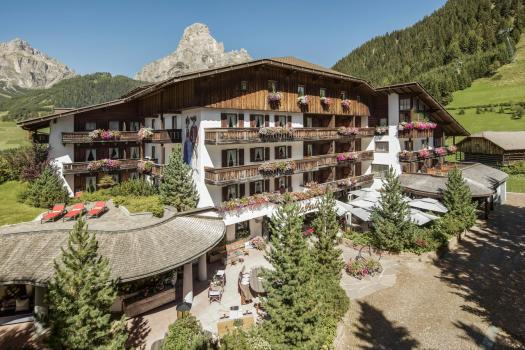 Exterior of Hotel La Perla in Corvara. Book your stay at Hotel La Perla here. Planning your summer in the mountains of Alta Badia.