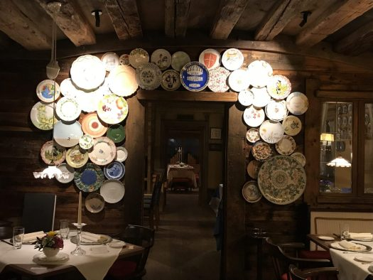 Plates collections exhibited in one of the stübes of the hotel La Perla. Book your stay at the Hotel La Perla here. Planning your summer in the mountains of Alta Badia.