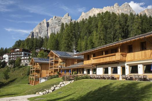 Exterior of Dolomiti Lodge Alverà. Book your stay at the Dolomiti Lodge Alverà here. Cortina d'Ampezzo is ready for a new summer season.