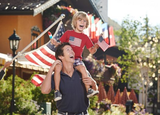 A father and son enjoy 4th of July in Vail Village, Colorado. Photo: Jack Affleck. Vail Resorts. The Must-Read Guide to Vail.