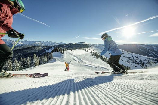 Friends Skiing Groomed Terrain in Vail, CO.. Photo: Daniel Milchev. Vail Resorts. The Must-Read Guide to Vail.
