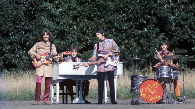 The Beatles perform 'I Am The Walrus' for the film Magical Mystery Tour.  West Malling Air Station, Kent, England. 20th September 1967. 	Images may be editorially reproduced only in conjunction with the 2012 DVD & Blu-ray / digital release of Magical Mystery Tour. 	Please credit © Apple Films Ltd. 	Promotional and review purposes only.