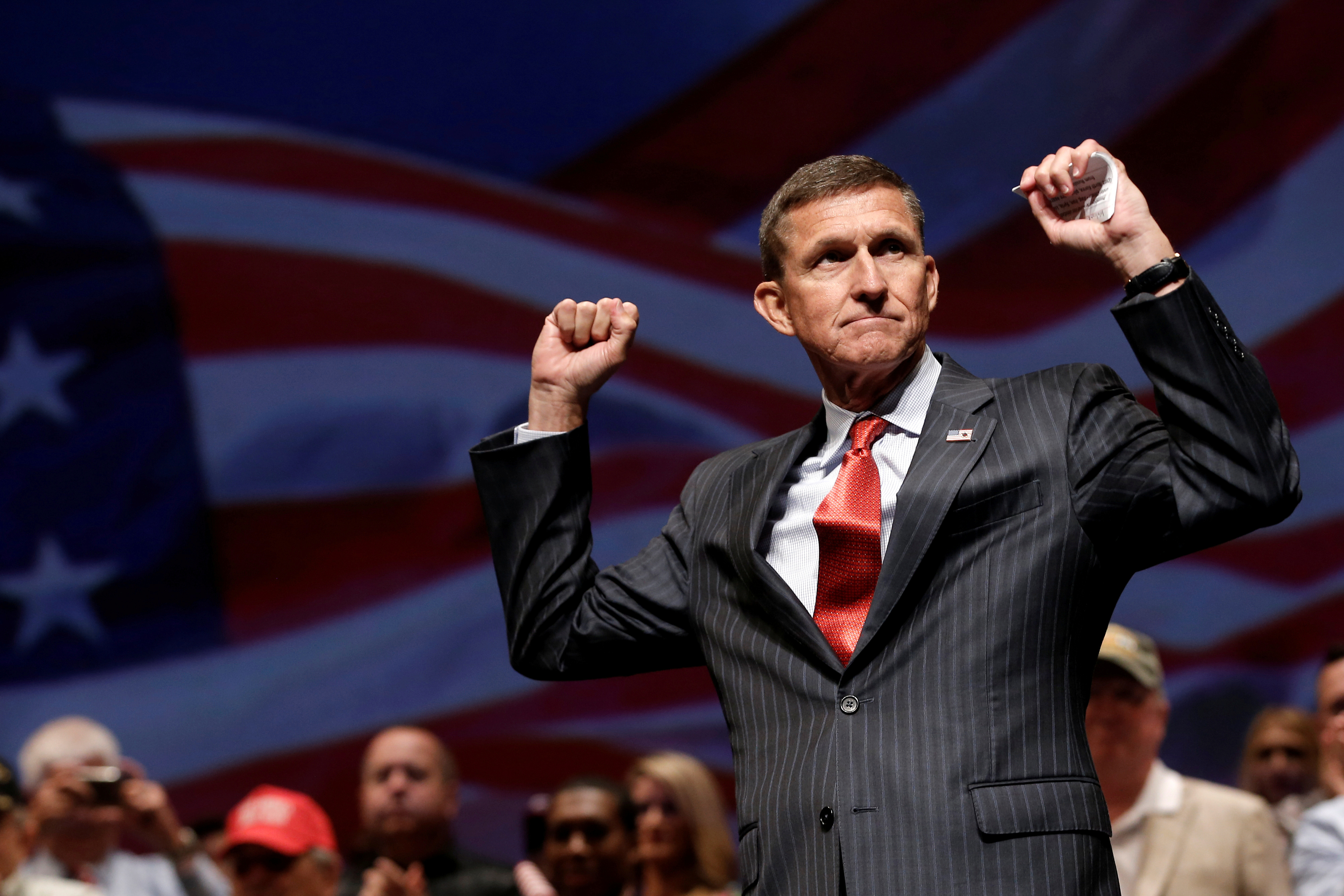 Flynn reacts at a campaign event for Republican presidential nominee Donald Trump in Virginia Beach