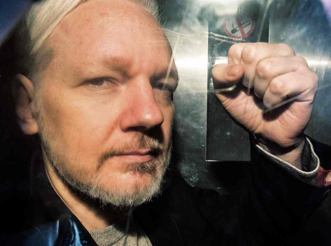 Julian Assange makes a hand gesture in London on May 1, 2019