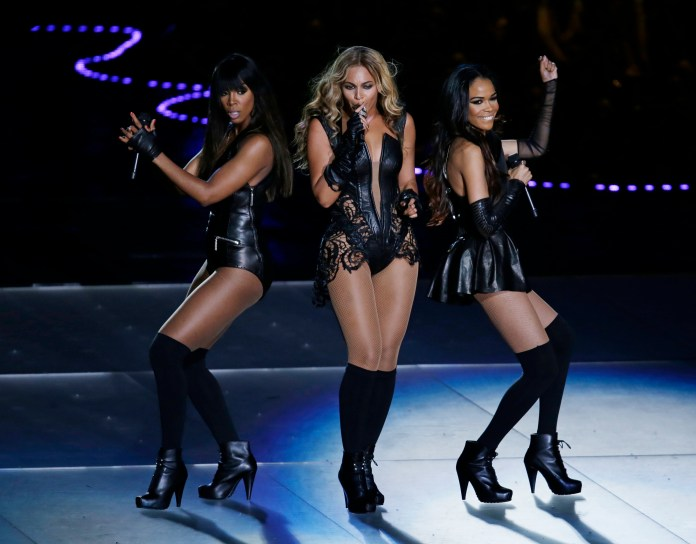 Beyonce performs with Kelly Rowland, left, and Michelle Williams, right, of Destiny's Child, during the halftime show of the NFL Super Bowl XLVII football game between the San Francisco 49ers and the Baltimore Ravens, in 2013