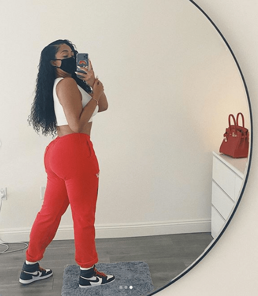 When not on the table, the 22-year-old model wore a white cropped top and red sweatpants to the appointment