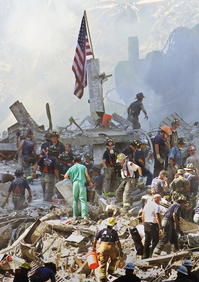 An American flag is displayed in the rubble of the World Trade Center two days after the terror attacks