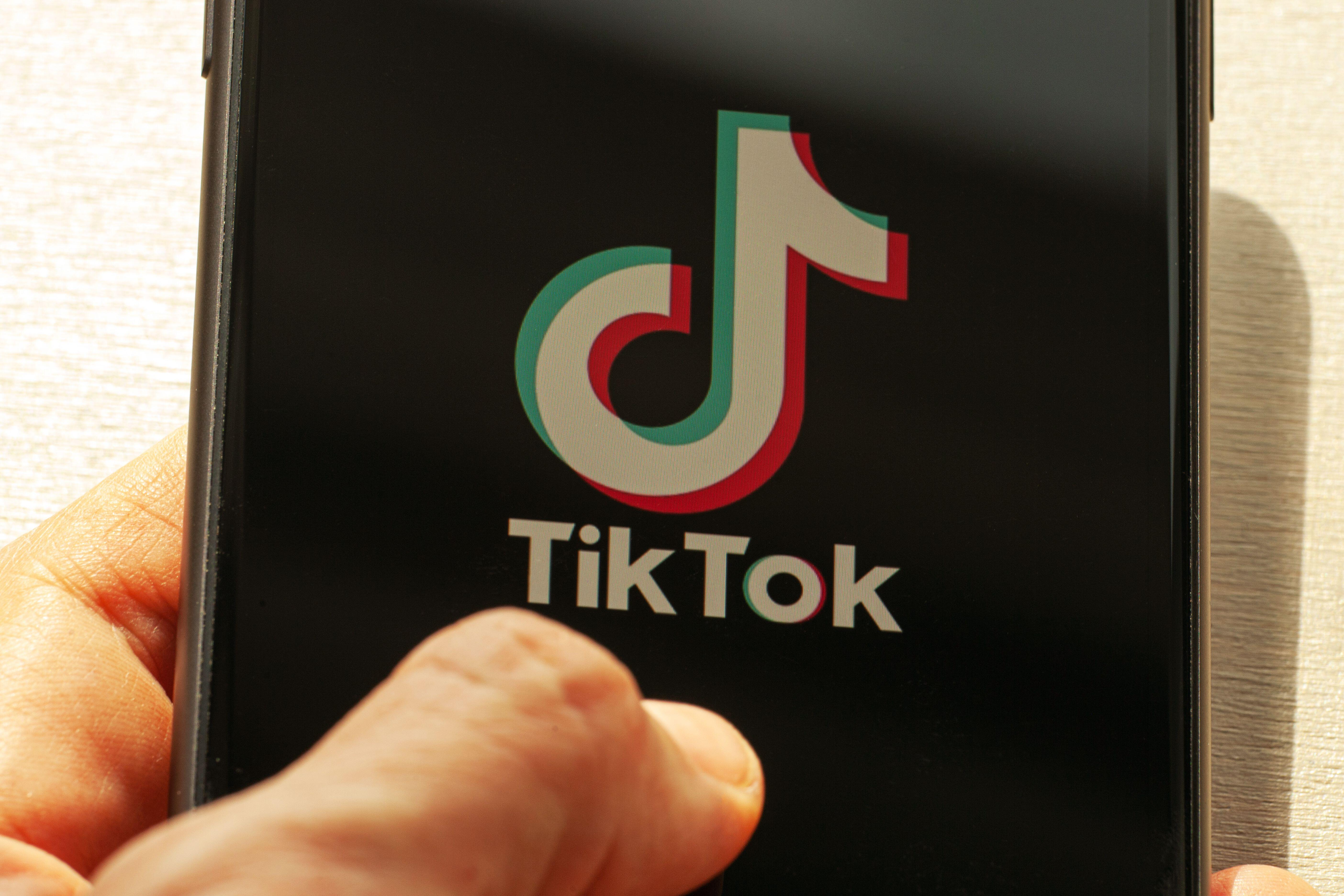 TikTok bans ALL QAnon conspiracy content in disinformation crackdown after similar move by Facebook and Twitter