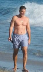 Shirtless Rob Lowe, 56, looks half his age as he hits the beach in swim trunks