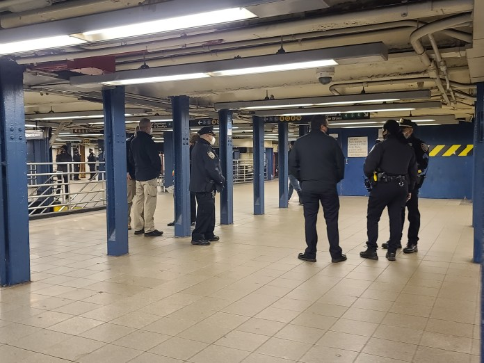Police are seen in Union Square subway station, near where the attack took place