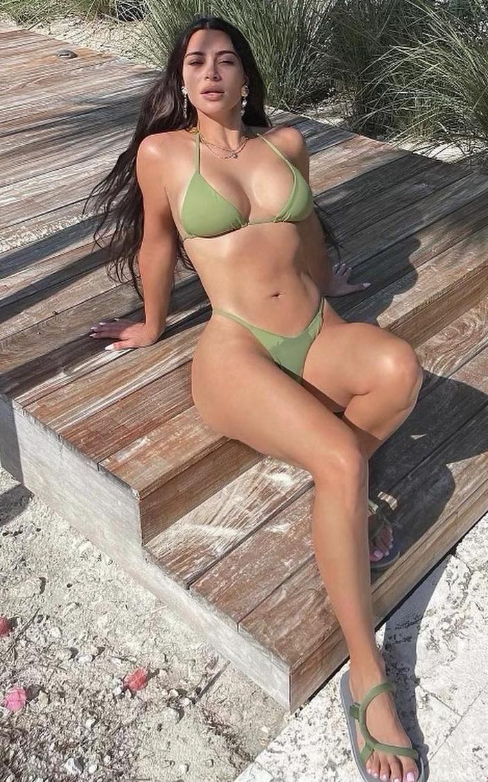 Kim Kardashian turned up the heat by posing in a skimpy green bikini