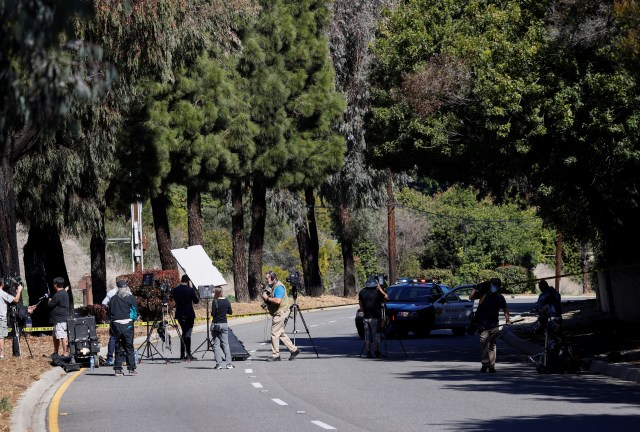 Members of the media gather near the scene in Los Angeles